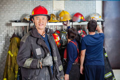 Smiling Fireman Standing At Fire Station Stock Photography