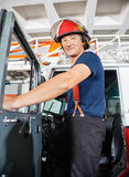 Smiling Fireman Standing On Truck Stock Photography