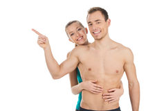 Smiling fit couple looking at camera. Royalty Free Stock Images