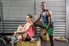 Smiling fit couple posing. At crossfit gym Royalty Free Stock Photo