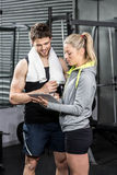 Smiling fit couple taking notes Royalty Free Stock Photos