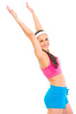 Smiling fit female in sportswear making exercise Royalty Free Stock Photos