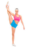 Smiling fit female standing in gym split Stock Images