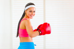Smiling fit girl in boxing gloves Royalty Free Stock Photo