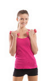 Smiling fit girl with dumbbells looking at camera Royalty Free Stock Photography