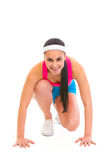 Smiling fit girl in start position ready for race Royalty Free Stock Photography