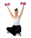 Smiling fit girl working out with dumbbells Stock Image