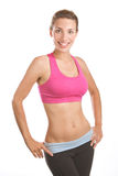 Smiling Fit Woman. A thin athletic woman smiling and posing Royalty Free Stock Photography