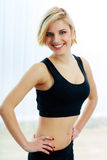 Smiling fit woman in black sports bra Royalty Free Stock Photography