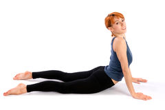Smiling Fit Woman doing Yoga Exercise Stock Photos
