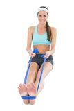 Smiling fit woman exercising with a blue yoga belt Stock Photography
