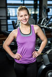 Smiling fit woman with hands on hips royalty free stock photography