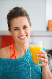 Smiling fit woman holding fresh juice in a glass Stock Image