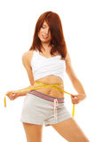 Smiling fit woman with measure tape. Royalty Free Stock Photography