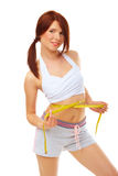 Smiling fit woman with measure tape. Royalty Free Stock Image