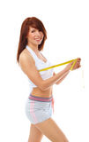 Smiling fit woman with measure tape. Royalty Free Stock Images