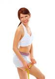 Smiling fit woman with measure tape. stock images