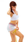 Smiling fit woman with measure tape. royalty free stock photos