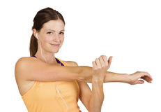 Smiling Fit woman stretching Royalty Free Stock Photo