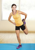 Smiling Fit woman stretching Royalty Free Stock Image
