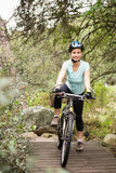 Smiling fit woman taking a break on her bike Royalty Free Stock Photo