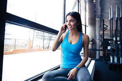 Smiling fit woman talking on the phone Stock Images
