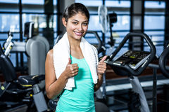 Smiling fit woman with thumbs up Royalty Free Stock Image