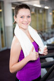 Smiling fit woman with towel around her neck Royalty Free Stock Images
