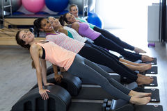 Smiling fit women exercising on arc barrel Royalty Free Stock Photography