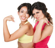 Smiling Fit Women Flexing Stock Photography