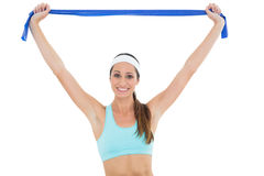 Smiling fit young woman with a blue yoga belt Stock Photo