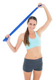 Smiling fit young woman holding blue yoga belt Royalty Free Stock Photography