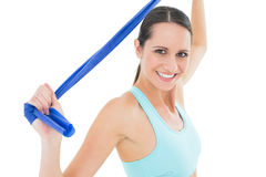 Smiling fit young woman holding blue yoga belt Royalty Free Stock Photo
