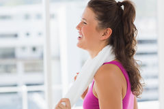 Smiling fit young woman with towel in gym Royalty Free Stock Photo