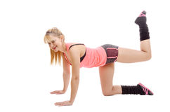 Smiling fitness beauty sexy woman exercising isolated on white Stock Photo