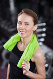 Smiling fitness beauty woman with towel Royalty Free Stock Photo