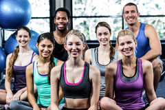 Smiling fitness class posing together Stock Image