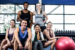 Smiling fitness class posing together Royalty Free Stock Images