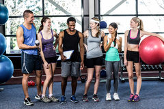 Smiling fitness class posing together Royalty Free Stock Photos