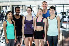 Smiling fitness class posing together Stock Photo