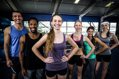 Smiling fitness class posing together with hands on hips Stock Photo