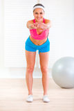 Smiling fitness girl doing exercises at room Stock Image
