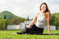 Smiling fitness girl outside on spring sunny day Royalty Free Stock Image