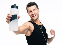 Smiling fitness man holding towel and bottle with water Royalty Free Stock Photo