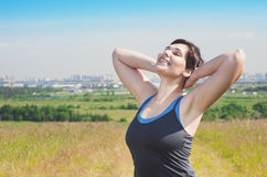 Smiling fitness plus size woman enjoy sunlight Royalty Free Stock Photo