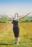 Smiling fitness plus size woman enjoy sunlight Stock Images