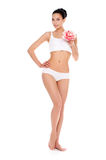 Smiling fitness sexy woman standing isolated in white. Stock Image
