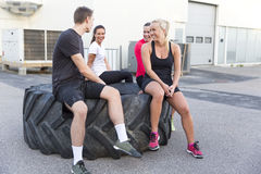 Smiling fitness team taking a break Royalty Free Stock Photo