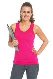 Smiling fitness trainer with clipboard Stock Image