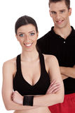Smiling fitness trainers. Over white background Royalty Free Stock Photos